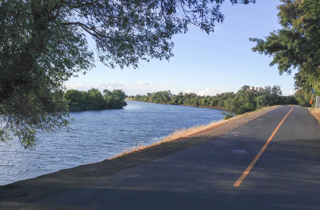 bike trail along sacramento river at sunset