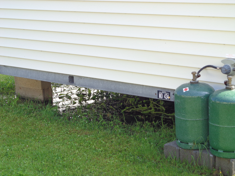Water ponded under trailers in campground due to last night's storm